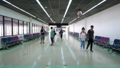 Old international airport passage at terminal airside, people walk, POV camera Stock Footage