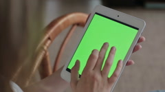 Woman hands touching and scrolling tablet.green screen display Stock Footage