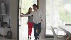 Young, happy couple entering new home, slow motion 120fps Stock Footage