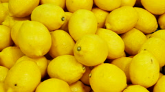 Colorful Display Of Lemons In Market - stock footage
