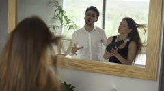 Young couple singing to hair-dryer in bathroom, slow motion 240fps Stock Footage