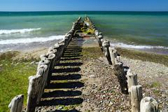 Breakwater goes into the sea - stock photo