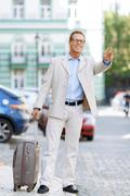 Hansome man holding his travel bag - stock photo