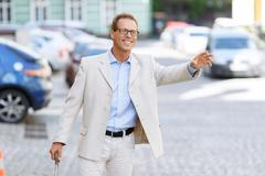 Hansome man holding his travel bag Stock Photos