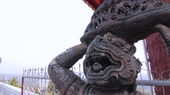 Buddhist Demon Statue Temple Entrance Protection Religious Monument Close Up Stock Footage