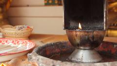 Buddhist Thai Temple Religious Prayer Alter Candle Flame Incense Burner Close Up Stock Footage