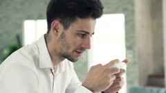 Young, handsome man playing game on smartphone at home, slow motion 120fps Stock Footage