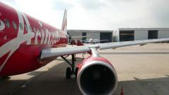 POV walk on airplane gangway, side view AirAsia red livery, airbus engine wing Stock Footage