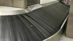 Empty luggage conveyor turn sliding around corner, close up view Stock Footage