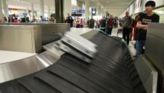 Luggage reclaim conveyor, plastic bag slide and fall on Stock Footage