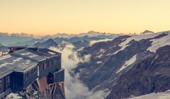 Alpine resort at sunset. - stock photo