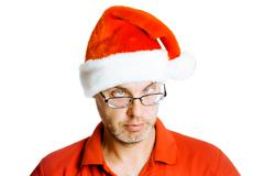 Unshaven slanting eyes Man in Santa hat. Isolated on white. Humor Stock Photos