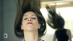 Portrait of elegant, serious woman throwing hair in bathroom, slow motion 480fps Stock Footage