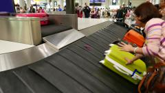 Women slow down hold suitcase slide down from outlet, prevent from damage Stock Footage