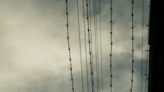 Outside of a prison camp barbed wire fence Stock Footage