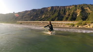 Stock Video Footage of A surfer dives into the waves.