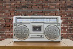 Vintage Boombox on Table with Red Brick Wall Stock Photos