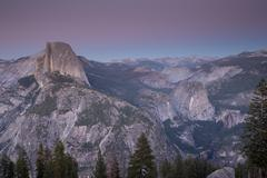 Famous Half Dome and surrounding views at Dusk Stock Photos