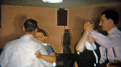 1955: Father dancing with mother in-law in cement lower level residence. Stock Footage