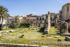 Ruins of the ancient greek doric temple of Apollo in Siracusa Stock Photos