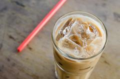 Glass Of Cold Coffee On Wood Table Stock Photos
