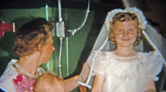 Stock Video Footage of 1955: Girl's first catholic communion cake party in family basement.