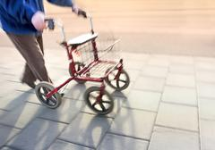 Senior citizen with walking frame Stock Photos