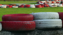 4K: Go Karts Race Around Track Behind Tire Bumpers Stock Footage