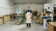 4K Portrait of smiling furniture maker in his workshop - stock footage