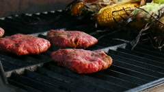 4K: Grilling Bacon Hamburgers On Hot Grate Stock Footage