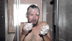 Desperate funny man in shower screaming for lost hair Stock Footage