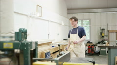 4K Professional carpenter in his workshop, measuring timber ready to be cut - stock footage
