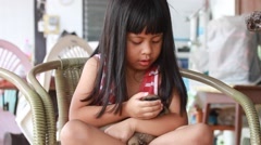 Beautiful asian girl and cuddly puppies Stock Footage