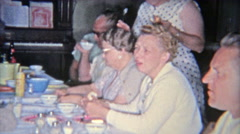 1955: Family drinking Budweiser Beer at the kitchen table during thanksgiving - stock footage