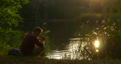 Man is Sitting at The Lake With His Hands Folded Pray Man Has Stood Up Took His Stock Footage