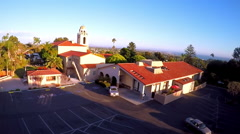An aerial shot over a California mission tower. - stock footage