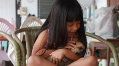 Cuddly puppies and little girl Stock Footage