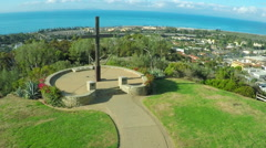 An aerial shot over a California christian cross over the city of Ventura. - stock footage