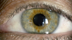 Female green eye close up extreme macro,iris contracts slow motion Stock Footage