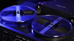 Reels spinning on portable videotape machine Stock Footage