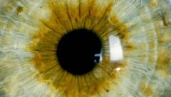 Female green eye close up extreme macro zoom in iris Stock Footage