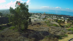 An aerial shot reveals the California coastal city of Ventura with winding roads Stock Footage