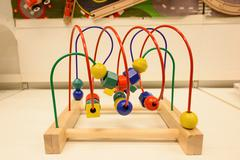Wooden abacus or geometric counting toy Stock Photos