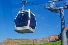 Funicular on green valley - stock photo