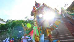Colorful Buddhist Demon Statue Thai Temple Steps Sunlight Lens Flare Hand Held Stock Footage