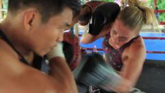 Female Fighter Boxing Training Hitting Pads Muay Thai Gym Hand Held Stock Footage