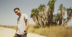 Handsome hispanic man standing outdoors and smiling Stock Footage