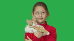 Girl and funny ginger kitten mewing Stock Footage