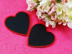 hearts on pink background and flower - stock photo