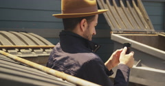 Happy Hispanic man using smartphone outdoors - stock footage